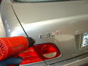 The easiest way to remove the emblem is to heat up the letters using a heat gun or a hair dryer.
