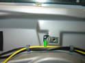 Loosen the Torx adjustment bolt at the top of the door (green arrow).