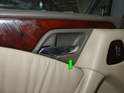 Pry out the surround piece around the door handle (green arrow).