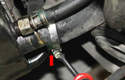 Remove the large lower radiator hose at the bottom of the radiator.