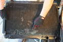 Inspect the radiator for signs of damage.