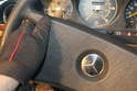 Before the steering wheel can be removed, the steering wheel pad must be removed.