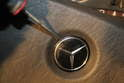 An alternative method to remove the steering wheel without removing the pad involves the removal of the emblem in the center in order to access the Allen screw.