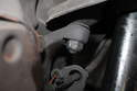 Do not remove the shock absorber. The first nut to remove is on the steering knuckle.