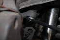 Using a 19mm open-end wrench, loosen and remove the nut from the ball joint..