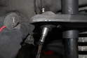 After the ball joint is free, the upper control arm should be able to move up and down.