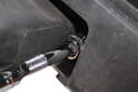 Using a 12mm socket wrench, loosen and remove each bolt that holds the fog lights to the bumper.