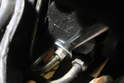 Using a 17mm and 22mm open ended wrench, loosen the two fluid lines leading to the steering gearbox.