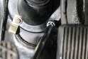 Using a 10mm socket, unscrew the pinch bolts at the base of the steering column.