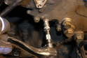 Using a 10mm socket, remove the bolts that hold the front cover plate to the engine.