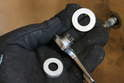 There are two plastic bushings along with the smaller release lever that will be part of the assembly.