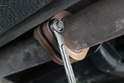 Using a 12mm wrench, loosen and remove the bolts that hold the exhaust line located past the oxygen sensor.