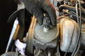Loosen and remove the cover to the power steering fluid pump.