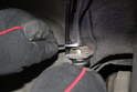 Using a 9mm and 14mm open end line wrench, loosen and dissemble the flexible brake line.