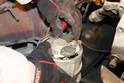 Once the alternator is free from the bracket and belt, turn it over and disconnect the electrical connector.