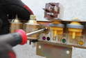 Using a Phillips head screwdriver, the switchover valves can be loosened and replaced.