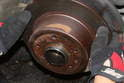Remove the brake disc from the rear axle shaft flange.
