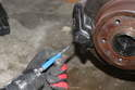 Careful not to hit the pins too hard as you may damage the calipers or rotor.