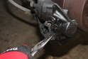 Using needle nose pliers, pull out the brake pad.