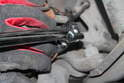 Using a 10mm socket, loosen and remove the brake sensor from the caliper.