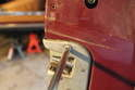 In order to remove the door latch, you will first have to remove two Phillips screws on the inside of the doorjamb.