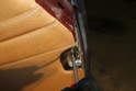 Using a Phillips head screwdriver, remove the cover for the door clasp.