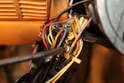 Using a Phillips head screwdriver, loosen the positive wire from the switch.