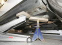 Lift the vehicle to the point that you can place your jack stand under the vehicle at its lowest height.
