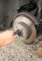 The parking brake's shoes contact the rotors' â€Ã...