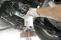 Drain the fuel trapped in the pump into an approved container.