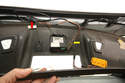 This view with the windshield panel removed shows the electrical connectors for the microphone (red arrow) and HomeLink (yellow arrow).