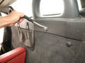 A trim panel tool is handy for removing the plastic plugs that hold the roll bar panel onto the body studs.