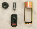 This job's players are the lock cover, cylinder, key, cover tool and key fob.