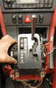 Once the fasteners are removed, the shifter assembly can be carefully angled out from underneath the console's rails.