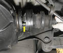 Once the bolts are out or their heads are cut off (yellow arrow), the axle shaft can be lifted out of the car.