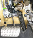 We removed the lower IP cover for a clearer view at the brake switch (arrow).