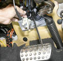 Depress the brake pedal while inserting the new switch to allow plunger clearance.