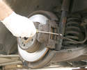 If the pistons aren't frozen or damaged, the old pads can be pried out with a flat head screwdriver.