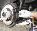 With the caliper bolted back on the car, the replacement pads can be inserted.