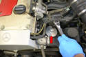 Place your oil filter socket (red arrow) over the filter and remove it.