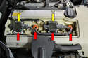 With the plate out of the way you can see the coils (yellow arrows), wires and plugs (red arrows).