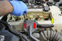 Use a 5mm Allen and remove the two bolts (red arrows) holding the oil separator to the valve cover.