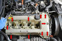 Use a 10mm socket and remove the 9 bolts holding the valve cover to the head (red arrows).