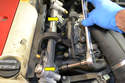 Remove the two E12 blots holding the fuel rail in place (yellow arrows).