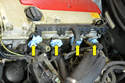 Be sure to put a few rags in the open holes in the manifold to prevent anything from falling into the engine (yellow arrows).