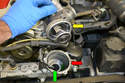 You can see in this picture that unless the coolant is hot the thermostat remains closed (yellow arrow) and trying to get water into the engine by the upper hose will do nothing but push the water back out all over you.