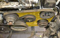 This photo shows the routing of the main Poly-V belt (yellow area).