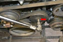 You are going to remove the Poly-V belt from the coolant pump but you do not need to remove it completely from the engine unless you are going to replace it.