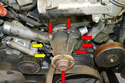 Remove the six E8 Torx (red arrows) and two E10 Torx (yellow arrows) bolts holding the pump to the engine.