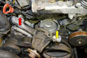 Pull the pump off the block (yellow arrow); this will give you more room to remove the heater hose (red arrow).